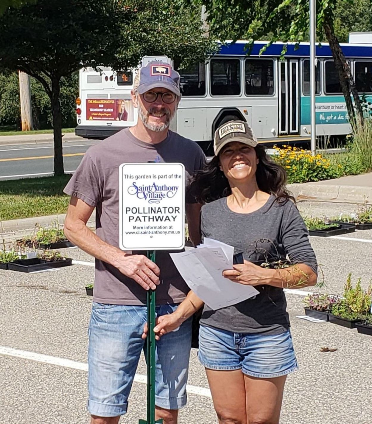Pollinator Plant Giveaway 2018-residents with their pollinator sign
